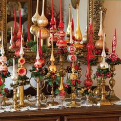 Great display of old brass candlesticks,with vintage glass tree toppers