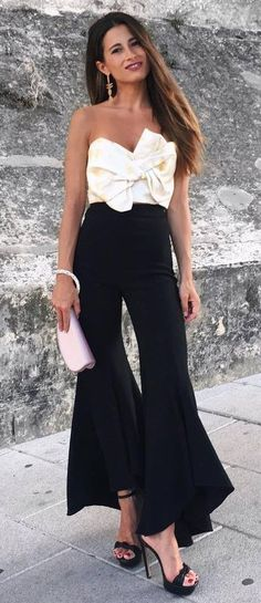 elegant outfi white off shoulder top heels black wide pants