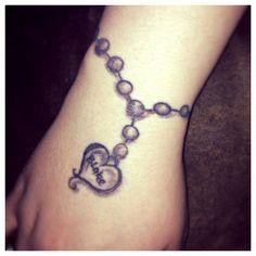 Heart charm bracelet wrist tattoo