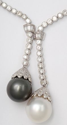 diamondsinthelibrary:    Detail: Boucheron Diamond Sautoir with South Sea Pearls. A rare and fabulous Boucheron diamond sautoir with South Sea pearls. 10ct of finest quality diamonds and 15mm exceptional South Sea pearls in a 18kt white gold setting. Via @1stdibs.