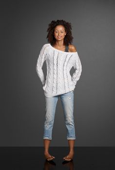 Hand-beaded detailing add the perfect pretty touch to a pair of destroyed boyfriend jeans. Put on a lace tank and let your open-stich sweater fall off your shoulder for an effortlessly sexy look.