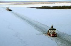 The Mackinaw breaking a path for a downbound merchant vessel in Munuscong Bay on the St. Mary's River in  December 2013. Photo courtesy of U.S. Coast Guard Air Station Traverse City.