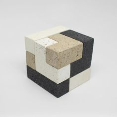 Cool's interpretation of a soma cube with a mixture of our favorite terrazzo concrete textures. As with other soma cubes, there is 240 possible ways to put it together.Designed by Mike GarmanSize: x x Tim. Footer Design, 2020 Design, Sculpture Art, Sculptures, Milk Shop, Concrete Texture, Cube Design, Concrete Crafts, Robot Design