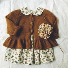 A top down knitted cardigan with a cute swing. The design is a little shorter as regular cardigans, so that the peplum skirt finds its perfect expression right under the waist. Sizes: 9-12 months (12-18 months) 2 yrs (4 yrs) 6 yrs (8 yrs) 10 yrs Measurements: Bust measurement: 50 (54) 58 (63) 67 (73) 79 cm Length: 26 (28) 30 (32) 35 (39) 41 cm Suggested needles: Circular needle 31⁄2 and 4 mm / 60 cm and double pointed needles 4 mm Gauge: 22 sts / 28 rows = 10 x 10 cm M...