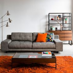 Eclectic living room with bright orange accent colour