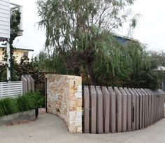 Curved Donnybrook stone entry wall and sleeper wall along drive Front Gate Design, Fence Design, Garden Gates And Fencing, Fences, Garden Path, Dream Garden, Sleepers In Garden, Stone Feature Wall, Garden Entrance