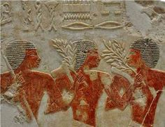 Soldiers carrying weapons and the olive branches of Victory, back from their expedition to Punt, East Africa. 18th dynasty. Mortuary temple of Hatshepsut.
