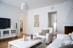 Sofas and armchair surround coffee table, TV cabinet and ceiling lamp