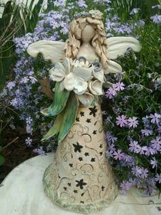 Hand built fairy candle holder with hand built flowers. No molds are used. Vintage Garden Pottey by Vickie Hundley Slab Pottery, Ceramic Pottery, Pottery Art, Angel Christmas Tree Topper, Christmas Angels, Ceramics Projects, Clay Projects, Pottery Angels, Clay Angel