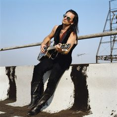 U2's Bono, on a rooftop, 1990. '50 Photos of Bono Being Bono-y'