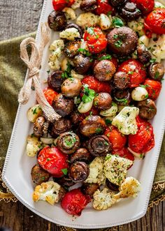 Italian Roasted Mushrooms and Veggies - absolutely the easiest way to roast mushrooms, cauliflower, tomatoes and garlic Italian style. Simple and delicious. dinner Italian Roasted Mushrooms and Veggies Veggie Dishes, Food Dishes, Christmas Vegetable Dishes, Easy Vegtable Side Dishes, Vegetables For Christmas Dinner, Healthy Vegetable Side Dishes, Tomato Side Dishes, Mushroom Side Dishes, Vegetable Meals