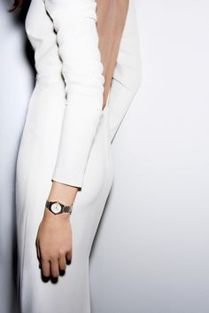 long, white, backless dress + gold watch