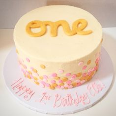 pink and gold polka dot first birthday cake