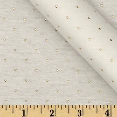 "Jewel Jersey Knit Ivory from @fabricdotcom  This polyester jersey knit fabric has a soft rayon-like hand, painted gold ""jewel"" dots and 40% stretch across the grain. Semi-sheer, it is perfect for creating layering tops and T-shirts."