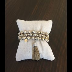 Stella & Dot Milana Tassel Bracelets Three separate stretchy bronze bracelets evoke a sophisticated bohemian look. Removable tassel, wear alone or layered. Fits SM-LG wrists. Stella & Dot Jewelry Bracelets