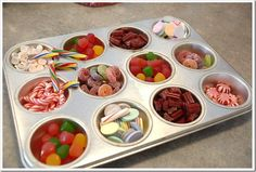 What a great idea to keep candies in while decorating gingerbread houses, you could even use the giant sized muffin tins if it was for a larger group to use.