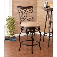The Robleda swivel counter stool features bar height seating, a cozy foam seat covered in plush mocha microfiber, and a scrolled backrest with a rich walnut finish wood accent. A full 360 degree swivel and footrest ring provide comfort and ease.