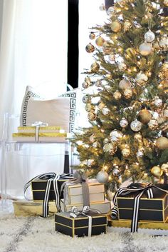 Glam holiday. Black and gold with touches of white and silver make for a very classic and beautiful Christmas tree.