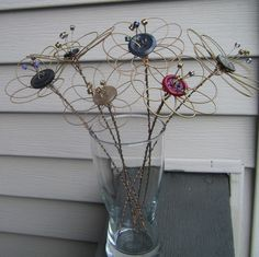 Cute example of Guitar String Flowers with buttons by Stringcycle on Etsy
