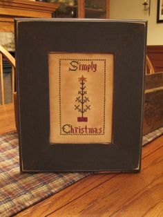 """Simply Christmas"" sampler.  Designed and stitched by Yesterday Once More Primitives."