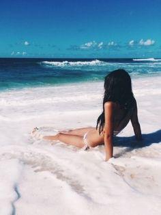 posar en la playa