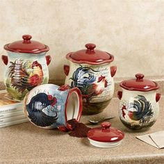 The Le Rooster Kitchen Canister Set is made of colorful handpainted earthenware with a glaze finish. Whimsical canisters have airtight red lids and roosters. Kitchen Decor Sets, Rooster Kitchen Decor, Kitchen Canister Sets, Rooster Decor, Kitchen Styling, Rustic Kitchen, Country Kitchen, Kitchen Ideas, Kitchen Layout