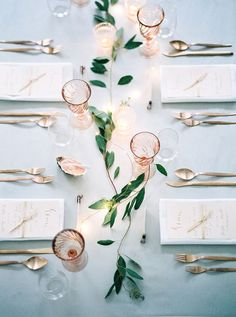Elegant, romantic tablescape with antique pink stemware   Photo by Peaches & Mint   Floral design by Viktoria Antal