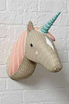 Shop Unicorn Charming Creatures Decor. You'll be more than charmed when you meet this animal wall décor. Each paper mache piece is hand painted, meaning no two are alike. They're perfect for a kid's room or even a nursery.