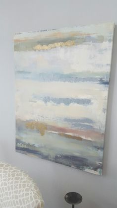 Neutral artwork with a hint of the ocean.