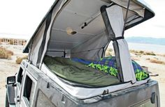 Looking to go camping in comfort ? Take a look at this 2007 Jeep Wrangler Unlimited Rubicon equipped with Ursa Minor's J30 hardtop camper conversion. #GoingCamping