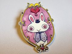 This colorful little pin back button brooch was created by printing my original watercolor bunny illustration onto bright white shrink plastic.