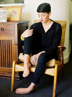 just like the short hair, black outfit, with fushia lipstick and bright yellow bracelet