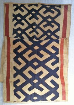 Beautiful Kuba Cloth from the Democratic Republic of Congo.  Kuba is made with raffia and traditionally used as skirts in dance ceremonies.  This one is exceptionally graphic and could be used as a table runner, wall hanging, or be made into several large pillows.  27