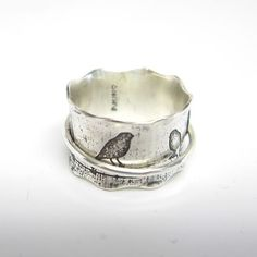 love this one      Birds on a Wire Silver Spinner Ring by janiceartjewelry on Etsy, $120.00: