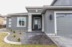 Paint colors are oh so important! Sherwin Williams Mined Coal was used for the body, and Sherwin Williams Pussy Willow for the trim of this contemporary home build by Prodigy Homes, Inc. Check out that stamped concrete!