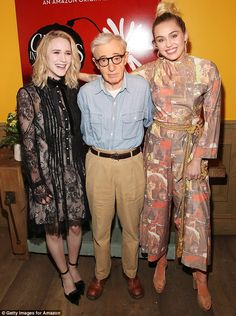 Having a blast: The high-neck one piece featured loose bottoms and a gold rope belt highlighting her slim waist; pictured with Wood and co-star Rachel Brosnahan