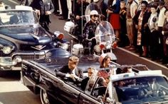 Live: U.S. President John F. Kennedy, First Lady Jaqueline Kennedy and Texas Governor John Connally ride in a liousine moments before Kennedy was assassinated, in Dallas