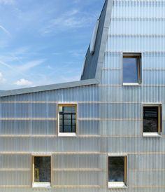 bunq architectes multipurpose building in gland, switzerland - designboom | architecture & design magazine