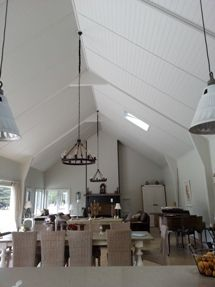 Grooved ply ceilings with portals for a grand country look