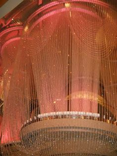 The Chandelier Bar at The Cosmopolitan Hotel, Las Vegas. Designed by: Architecture firm, Rockwell Group (More than 2 million crystal beads of varying sizes and facets were used to create these curtains, the largest quantity of beads to be used in one installation in North America).