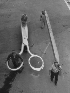 "On the set of ""The Incredible Shrinking Man"" (1957) Photo by Allan Grant of grips moving some of the giant props used to create the illusion of the protagonist's shrinking."