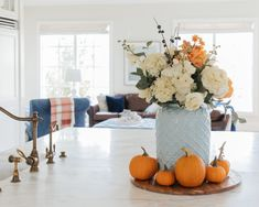With Fall approaching I decided to create a blue and orange fall tablescapes this year. This would make an excellent Thankgiving tablescapes. Teal and orange are some of my favorite colors to combine together. This beautiful fall decor with a combanation of blue and orange is one of my favoite tablescapes so far. For more simple Fall tablescapes visit Home with Holly J. Blue Living Room Decor, Blue Home Decor, Artificial Floral Arrangements, Flower Arrangements, Sunflower Centerpieces, Flower Decorations, Fall Decorations, Wooden Pumpkins, Baby Shower Fall