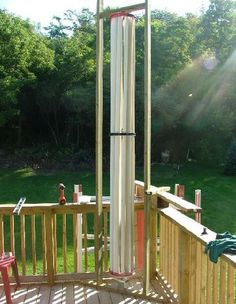"""This vertical axis wind turbine (VAWT) uses five 3"""" PVC pipes cut in half for blades rotating on three kids bicycle wheels to spin an Ametek 38 volt motor or a wind blue alternator. The whole th..."""
