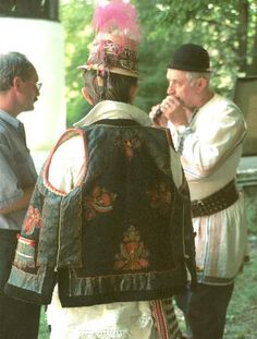 Romanian costume Lapuş - Maramureş  Brown pieptar, edged with black fur and decorated with red and green embroidery from the village of Costeni, Lapuş, Maramureş,  Photo taken at Astra Museum, Sibiu, August 1998 during a fair of traditional crafts.