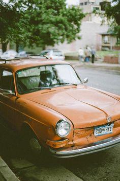 orange car + green trees