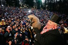 I think it would be fun to go to the groundhogs day celebration in Punxsutawney...it is one of the under celebrated holidays in my opinion!