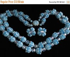 Vintage Retro Chunky Blue Collectible 1950's 1960's 2 Strand Necklace  https://www.etsy.com/listing/201700779/vintage-retro-chunky-blue-collectible?ref=shop_home_active_2&utm_content=bufferf2417&utm_medium=social&utm_source=pinterest.com&utm_campaign=buffer #vogueteam #etsygifts