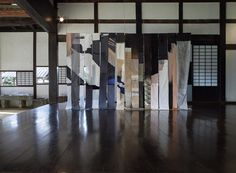 Tapestry for Traveling - Glitch from the Back Seat by Sanne Ransby. At INAKA art, Kumatori, Japan.  Photo: RINOT 210x300x30 cm Lasercuts in fabric and spraypaint