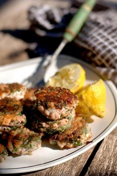 Fresh salmon cakes (with loads of dill). One of the best summer evening meals - accompanied by cold beer and eaten with your fingers!
