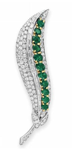 //AN EMERALD AND DIAMOND BROOCH, BY VAN CLEEF & ARPELS   Designed as a peapod, centering upon a line of oval-cut emeralds, to the circular and baguette-cut diamond shell and stem, mounted in gold and platinum  Signed Van Cleef & Arpels, N.Y., no. 56966